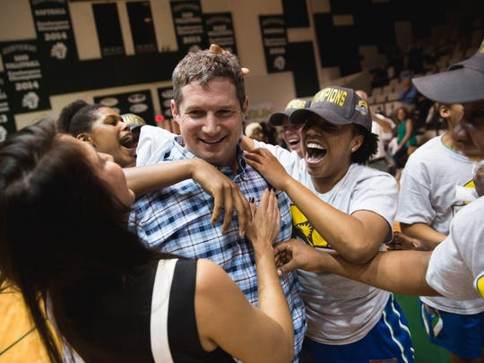 FGCU girls basketball coach Karl Smesko celebrates with his team after winning the Atlantic Sun Conference title.