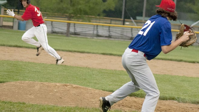 Ottawa Arrows pitcher Brett Had throws out a Garnett runner at second base after fielding a bunt Friday in Ottawa's 15-0 victory. [PHOTO BY GREG MAST/THE OTTAWA HERALD].