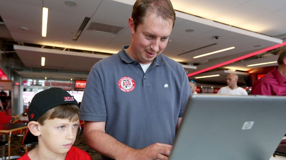 Will Kaiser, 9, watches his father, Travis Kaiser of
