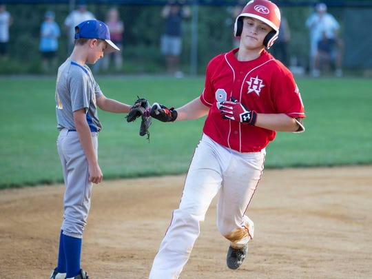 JR Osmond celebrates after hitting a home run. Holbrook defeats Manchester in the District 18 final.