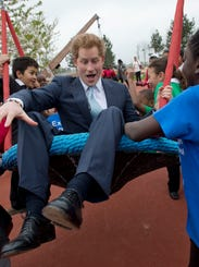 Prince Harry on a swing