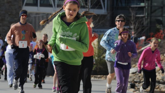 Hundreds participated in the Girls on the Run 5K at UNC Asheville. The nonprofit is holding a training for coaches.