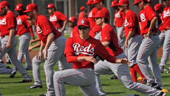 Pitcher Homer Bailey stretches with his teammates Thursday morning in Goodyear.