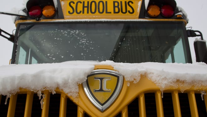 Icicles hang from one of the Tippecanoe School Corporation buses Tuesday, January 7, 2014.  TSC is rolling out a new mobile app that will tell parents when a bus is close to its stop, preventing the need for students to wait in the rain or snow.