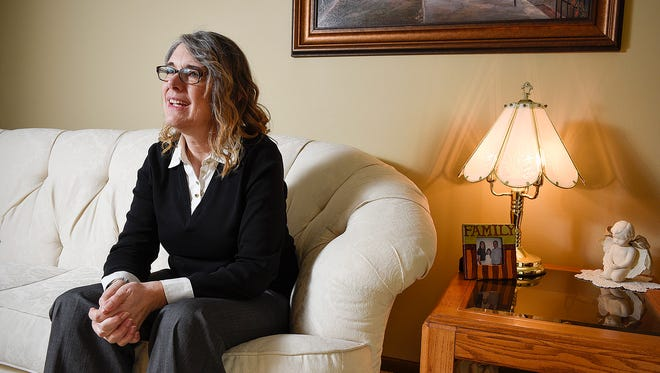 April Myers talks Wednesday, April 20, about the honor of being selected as the Sauk Rapids Citizen of the Year at her home in Sauk Rapids.