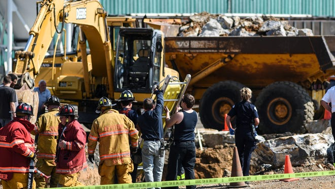 Emergency crews work to remove a contractor who was trapped up to his waist in dirt after a trench partially collapsed at Triple-M-Farms in South Lebanon Township on Monday, June 20, 2016.