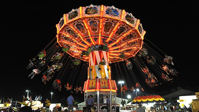 The Flying Circus ride spins riders over the midway at the NC Mountain State Fair.