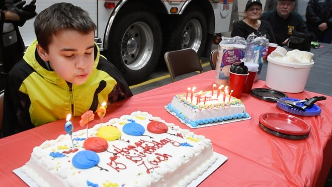 Zach Foller blows out the candles during a surprise birthday party at Eureka Fire Co in Stewartstown Sunday January 22, 2017.