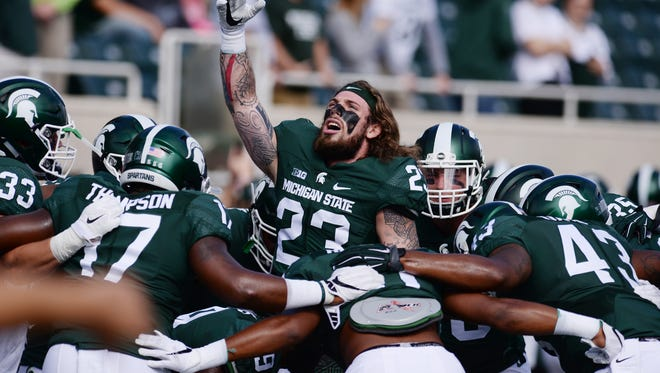 Linebacker Chris Frey (23), one of Michigan State's two senior captains this season, fires up his teammates before a game last fall.