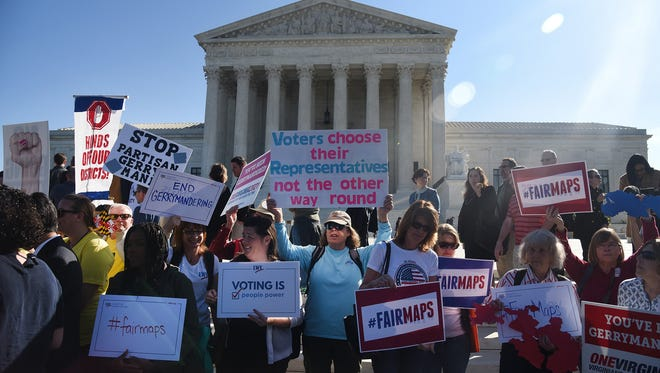 "Demonstrators gather outside of The United States Supreme Court during oral arguments in ""Gill v. Whitford"" to call for an end to partisan gerrymandering on Oct. 3, 2017, in Washington, D.C. The Supreme Court must decide whether the lower court's decision that the election maps for the Wisconsin state Assembly were so heavily Republican that they violated the constitutional rights of Democratic voters."