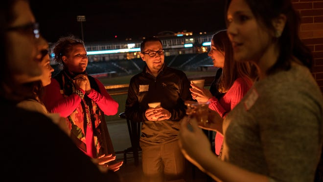 Guests mingle near the fire during Lansing 5:01's Capital Comeback event on Wednesday, November 22, 2017, at The View at the Cooley Law School Stadium. The networking event brought together current and former Lansing residents for the opportunity to connect with employers, organizations and each other while learning about all that the area has to offer for work and play.