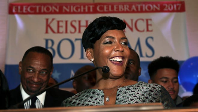 Atlanta mayoral candidate Keisha Lance Bottoms declares victory during an election-night watch party Wednesday, Dec. 6, 2017, in Atlanta. Atlanta's two-person mayoral runoff election is too close to call. Bottoms leads Mary Norwood by a margin of less than 1%, which is the threshold where the second-place finisher can request a recount under state law.