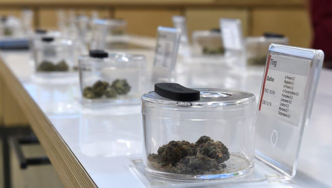 Customers can see and smell samples of marijunna at the Sierra Wells marijuana dispensary in Reno on Thursday Jan. 4, 2018.