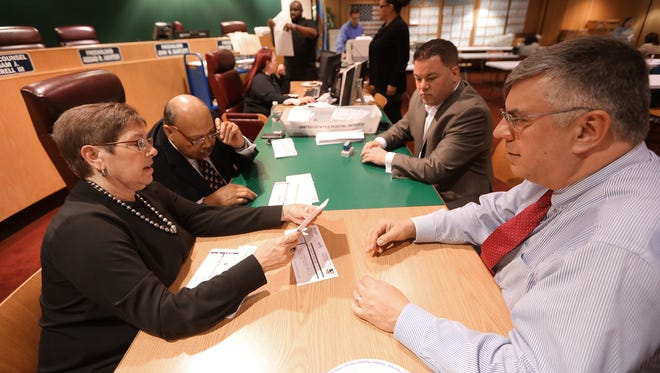 Rita Gernant (left,foreground), John Currie, Mike Ramaglia and John Traier (right,foreground) of the Passaic County Board of Elections, look over mail-in ballots, in Paterson, Tuesday, May 8, 2018.