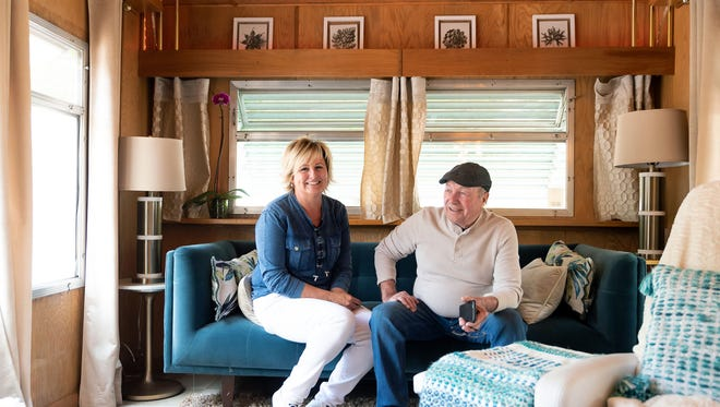 Kari Galgon and husband Manfred Galgon pose in a 1959 trailer that they rent out to tenants at the River West Resort RV and trailer park on Second Street. They restored the trailer and the current tenant decorated it with midcentury furniture to match the vintage colors and fixtures.