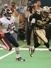 Chicago Bears return specialist Mill Coleman (86) runs past New Orleans Saints defender JeRod Cherry (37) as he returns a kick during preseason action in New Orleans Saturday, Aug. 17, 1996.