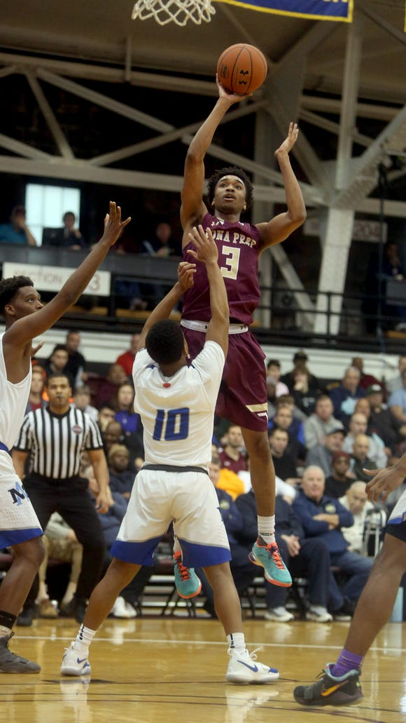 Bryce Wills of Iona Prep shoots over Orrin Barfield