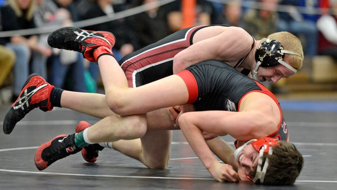 Pulaski's Bradley Prentice stays in control of Hortonville's Curtis Diedrich in the 126-pound championship match during Saturday's WIAA Division 1 wrestling sectionals at Green Bay West High School.