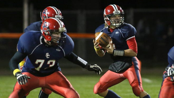 Spencer/Columbus quarterback Calvin Lenz drops back to look like he's passing before he runs with the ball against Altoona, Friday, October 2, 2015, at Beell Stadium in Marshfield. Lenz's Rockets beat Altoona 39-0.