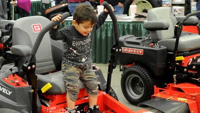 Mark Hamilton, 2, tests the lawn mowers at the Arts Alive! Home and Garden Festival Sunday, Feb. 26, 2017, at the MPEC. This year's event will be 9 a.m. to 6 p.m. Feb. 24 and 11 a.m. to 5 p.m. Feb. 25. The theme is 'A Place to Grow.'