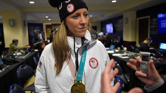 In this March 3, 2018, file photo, Meghan Duggan, of the gold medal-winning U.S. women's Olympic hockey team, listens to a question from the media before an outdoor NHL hockey game between the Washington Capitals and the Toronto Maple Leafs in Annapolis, Md. U.S. women's hockey captain Duggan announced her retirement Tuesday, Oct. 13, 2020, after a career in which she won the 2018 Olympic gold medal and seven world championship golds.