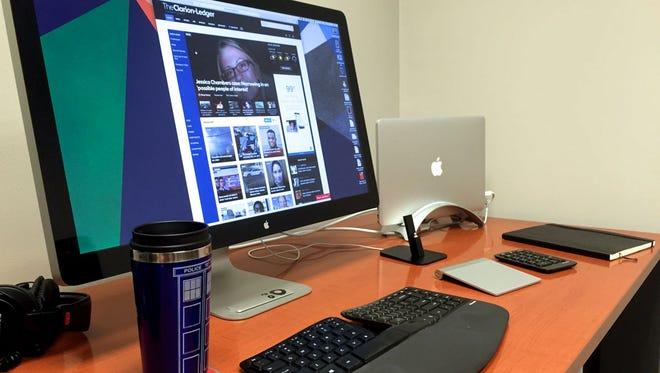 Executive Editor Sam Hall has lots of technology at his fingertips.