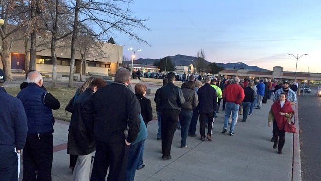 The line is long at Reed High School in Reno, which is supposed to have 2,000 caucus-goers.