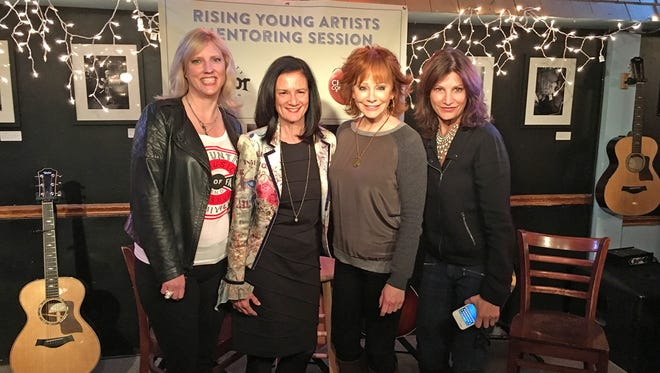 The Change the Conversation group recently launched its mentoring sessions for young artists at the Bluebird Café in Nashville. Pictured, from left, are Beverly Keel, chair of MTSU's Department of Recording Industry and co-founder of Change the Conversation; Leslie Fram, CMT senior vice president and Change the Conversation co-founder; country music legend and special guest Reba McEntire; and Tracy Gershon, Rounder Records Group's vice president of A&R and Change the Conversation co-founder.