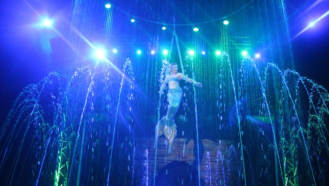 A mermaid hangs in the air amid Cirque Italia's 35,000-gallon fountains. The animal-free show has a three-day run in Springfield later this month.