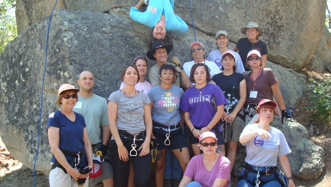 Rappelling was one of the highlights of the 2009 Becoming an Outdoors Woman camp for Jennifer Nerat (top), who posed with her fellow campers.