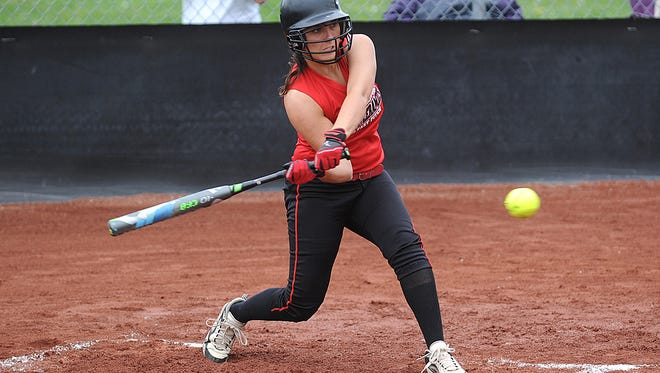 Crooksville's Kate Mills puts a ball in play against Tri-Valley.