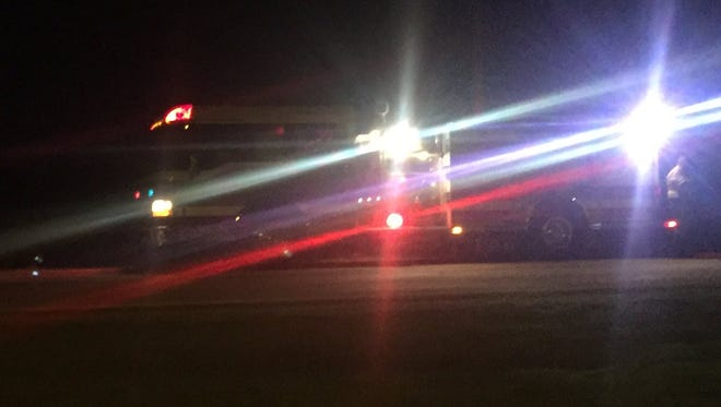 A firetruck blocks the road near the crash in Renner.