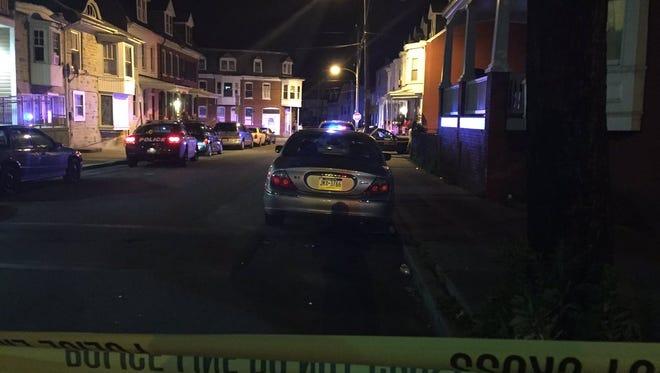Police tape marks off a scene on West Princess Street near South West Street.
