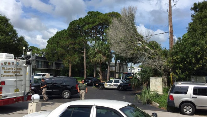 Scene from the 2500 block of South 17th Street in Fort Pierce as law-enforcement agencies investigate home connected to suspect in Orlando shootings.