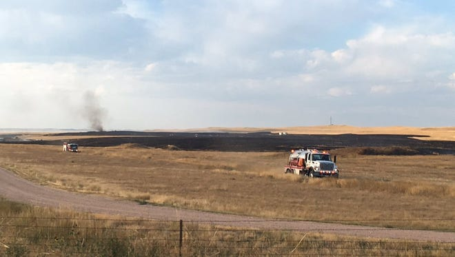Crews contained a grass fire that spread across Larimer County land north of Wellington on Sunday.