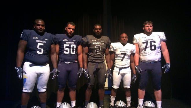 From left to right: Dimitirus Smith, Payton Minnich, Darnell Leslie, Darren Ambush and Matt Stoneberg show off Monmouth's new football uniforms