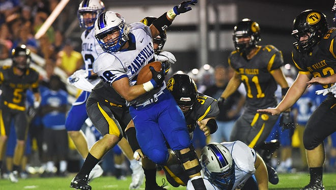 Zanesville's Caine Martin carries the ball during the Blue Devils' loss to Tri-Valley last year. Martin returns to the backfield as the Blue Devils and Scotties match 1-1 records Friday at John D. Sulsberger Stadium.