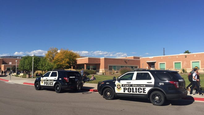 Two police cars sit outside Poudre High School Thursday, Sept. 29. Fort Collins Police Services and Poudre School District were notified Wednesday night of a single threat posted on Facebook.