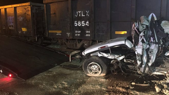 A pickup truck being loaded on a flatbed tow truck after it hit a train in Columbus.