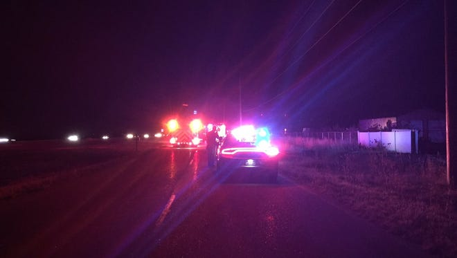 Emegency responders on the scene of a fatal vehicle-pedestrian crash on the Interstate 25 frontage road Thursday night.