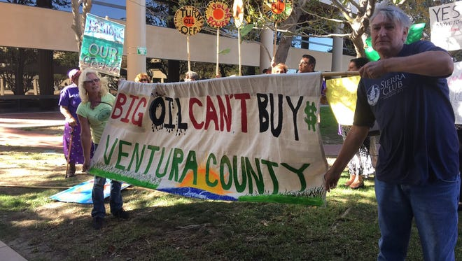 About 100 supporters of Carla Castilla, a candidate for the 3rd District seat on the Ventura County Board of Supervisors, rallied Wednesday to decry donations from the oil industry to her opponent, Kelly Long.