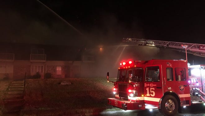 Firefighters battle a 2-alarm fire in South Nashville November 2, 2012.