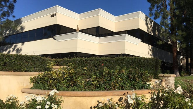 This is the building at 4165 E. Thousand Oaks Blvd. where developer Harry Selvin is fighting to install solar awnings.