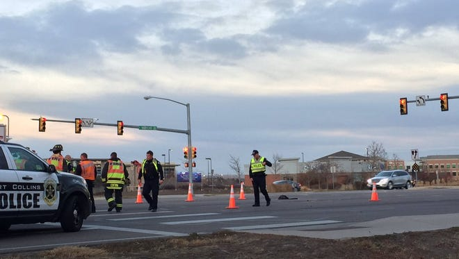 Fort Collins police officers investigate the scene of a reported hit-and-run crash at Harmony Road and Corbett Drive. A driver hit a pedestrian and fled the scene.