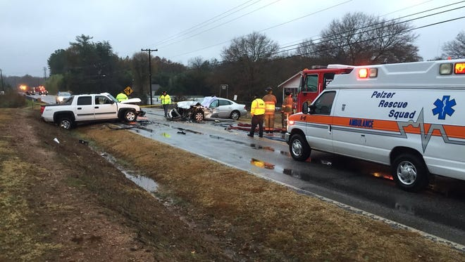 Emergency personnel work the scene of a head-on collision Tuesday morning on S.C. 20 in Greenville County near the Anderson County line. A man was killed in the crash.