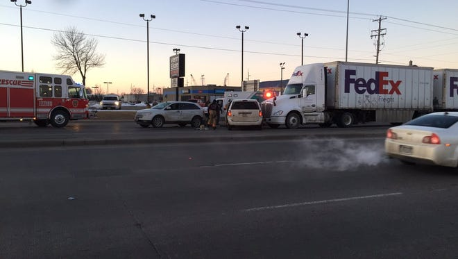 Traffic was backed up on 12th Street after a crash involving a semi and multiple vehicles.