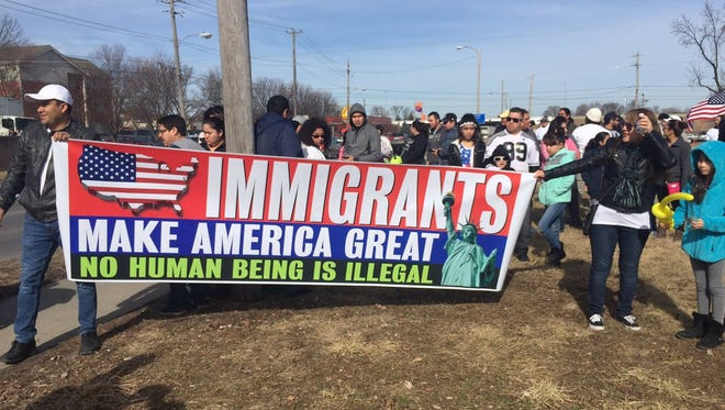 Thousands of people gathered Thursday morning in Des Moines to march to the state Capitol as part of the Day Without an Immigrant.