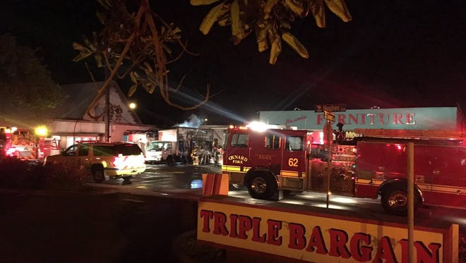 Firefighters knocked down fires in two furniture delivery trucks early Saturday in Oxnard.