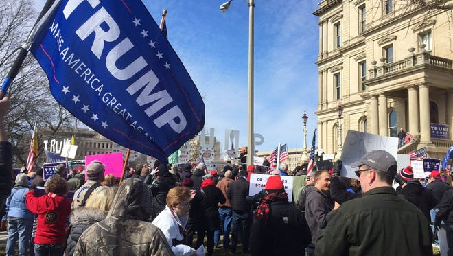 Supporters of President Donald Trump gather on the Capitol lawn in Lansing Saturday, March 4, 2017.