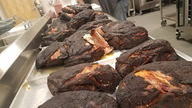 Pork butts prepared by pitmaster Anthony DiBernardo will be served to Greenville County Schools students as part of the Carolina Cooking curriculum. March 22, 2017
